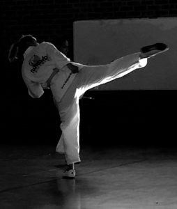 Taekwondo Blogger and Taekwondo Mum Kristy Hitchens tackles a turning kick.
